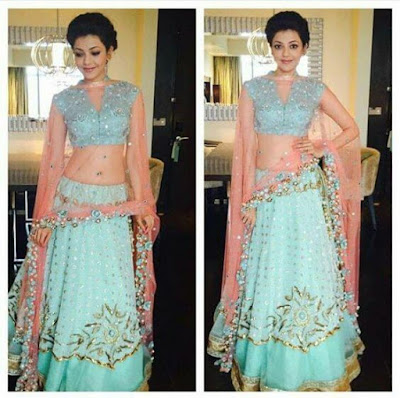 Kajal Aggarwal famous indian celebrity looking beautiful in pastel pink and blue lehenga with pearls.