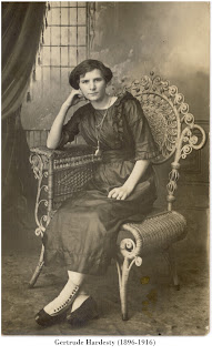 Image of Gertrude Hardesty (1896-1916), seated in a photographer's studio, likely in Lincoln County, Oklahoma.