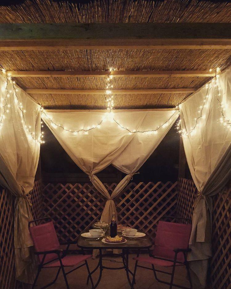 Lit porch sukkah | Land of Honey