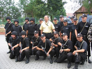 Lt. Dan Norris poses with the Polish SWAT team.