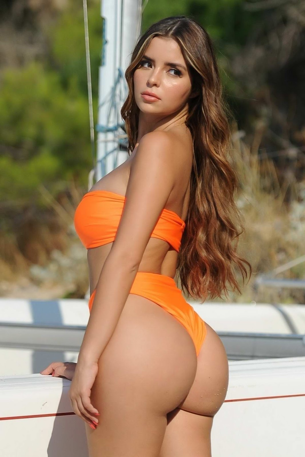 Demi Rose Mawby rocks an orange bikini during a photoshoot for clothing line Ibiza X By Demi Rose 2018