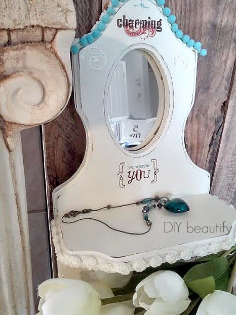 Paint and embellish a vintage mirror