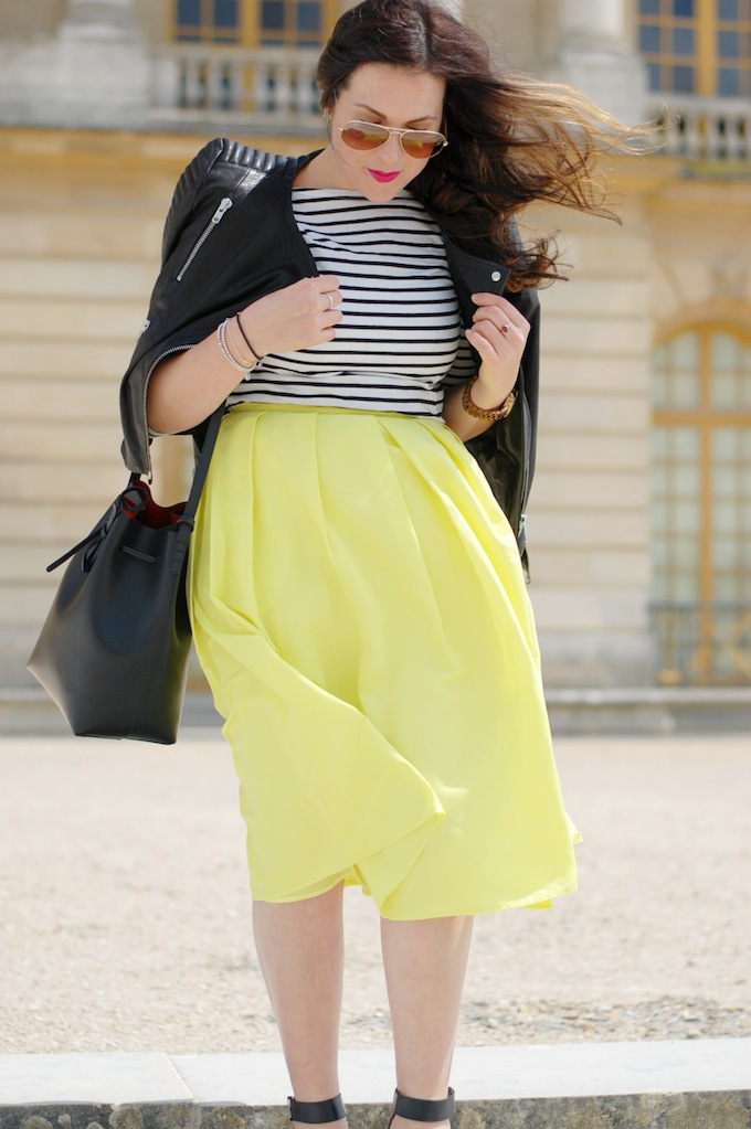 An outfit post featuring a 424 Fifth citron midi skirt, a stripe Forever 21 shirt and a Mansur Gavriel bucket bag shot at the Palace of Versailles by Vancouver fashion blogger Aleesha Harris of Covet and Acquire.