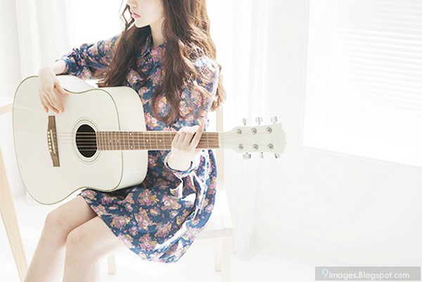 cute girl playing white guitar. Black Bedroom Furniture Sets. Home Design Ideas