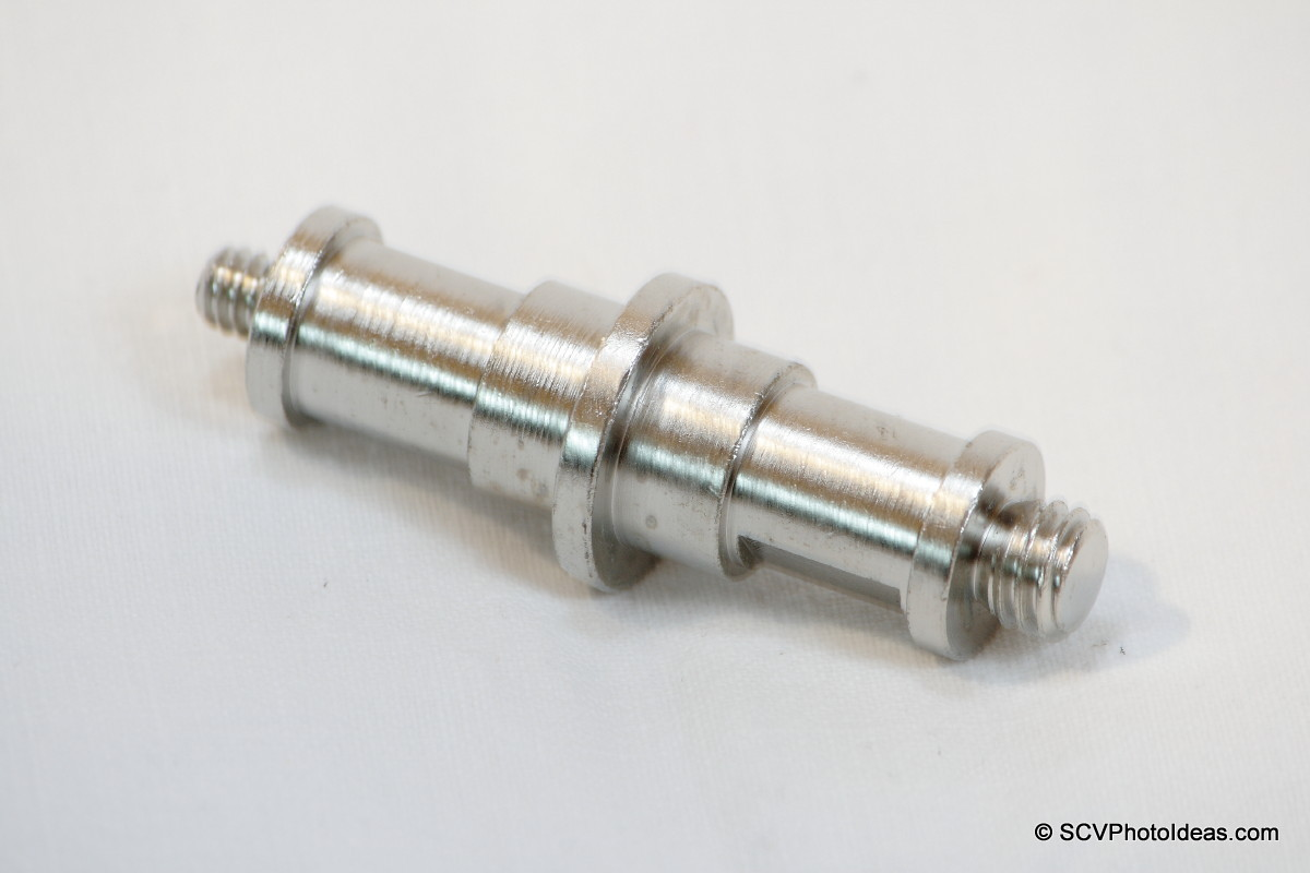 "Double spigot with 1/4""-20 & 3/8""-16 studs"
