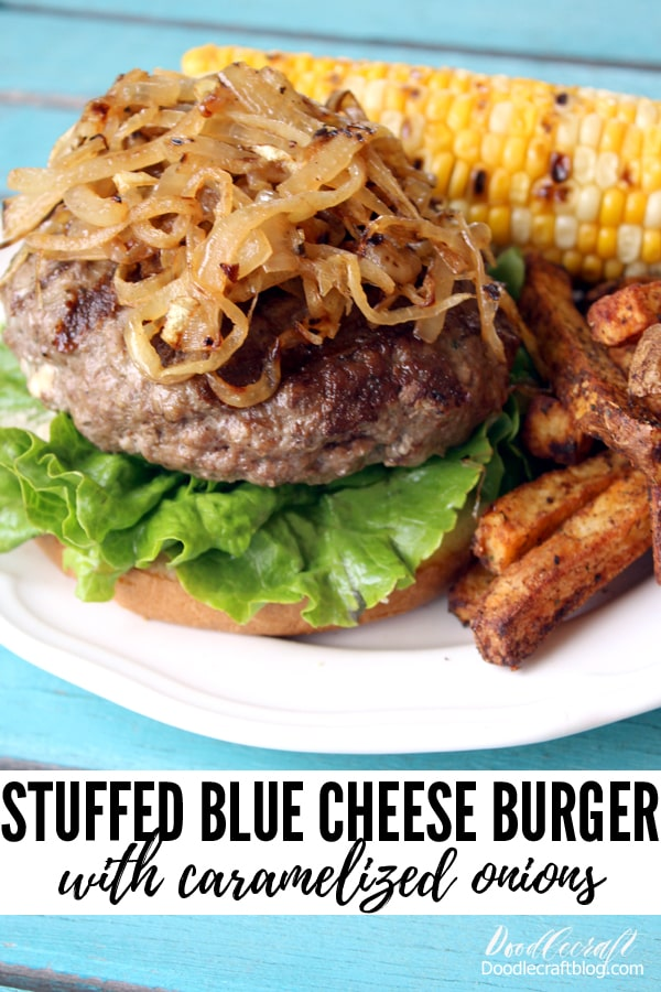 Delicious hamburger stuffed with blue cheese and grilled to perfection, topped with caramelized onions and served with grilled corn and french fries cooked in an air fryer.