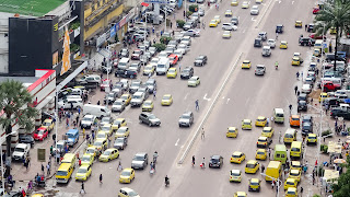 Yellow taxis and buses in Kinshasa