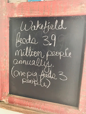 Photo of a chalk board with pork production facts