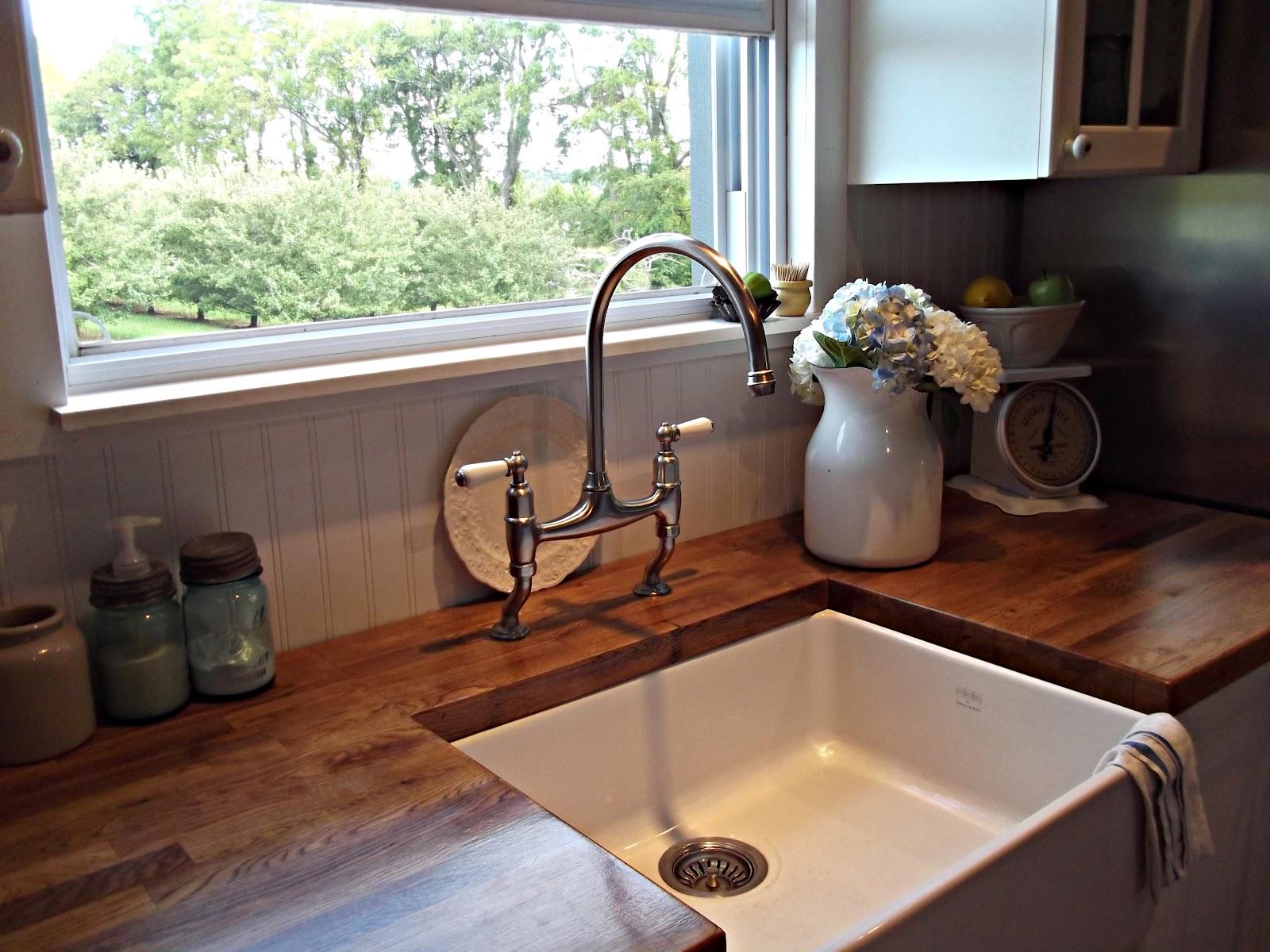 rustic farmhouse a farm style sink on kitchens with farmhouse sinks id=97062