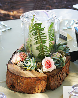 K'Mich Weddings - wedding planning - floral decor and tips - birch wood with votive surrounded by flowers for a centerpiece
