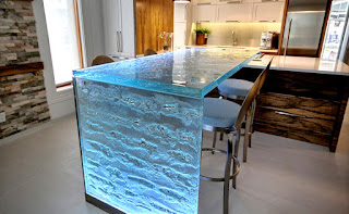 Blue Glass counter-tops and backsplash back-lit with custom LED light panels