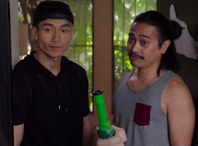 Jason and Donkey Doug. Donkey Doug is Filipino and has long black hair pulled back into a ponytail and a mustache, and is holding a neon green bong that has a giant fake hand around its base.