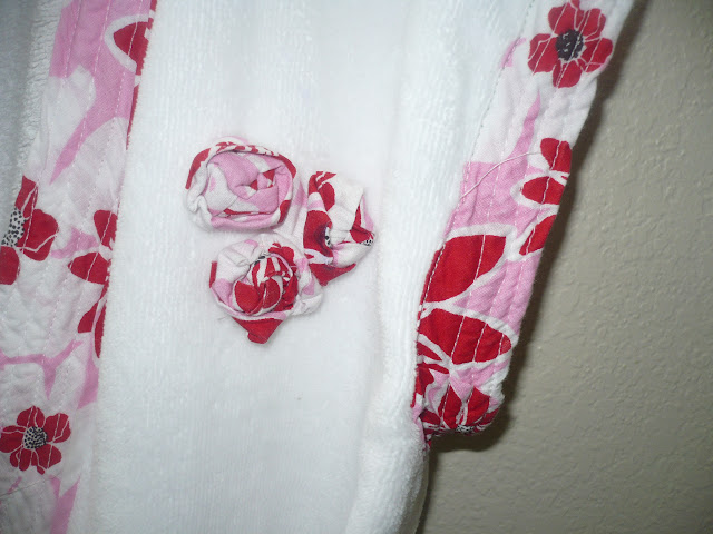 rosette embellishment on bathing robe