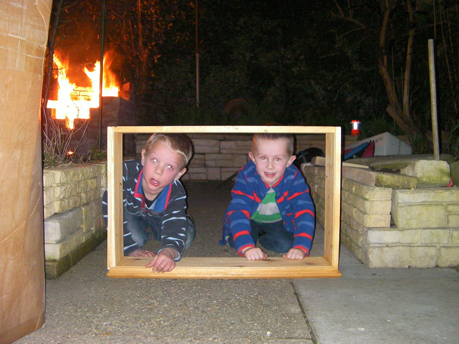 using box as a pretend TV home bonfire