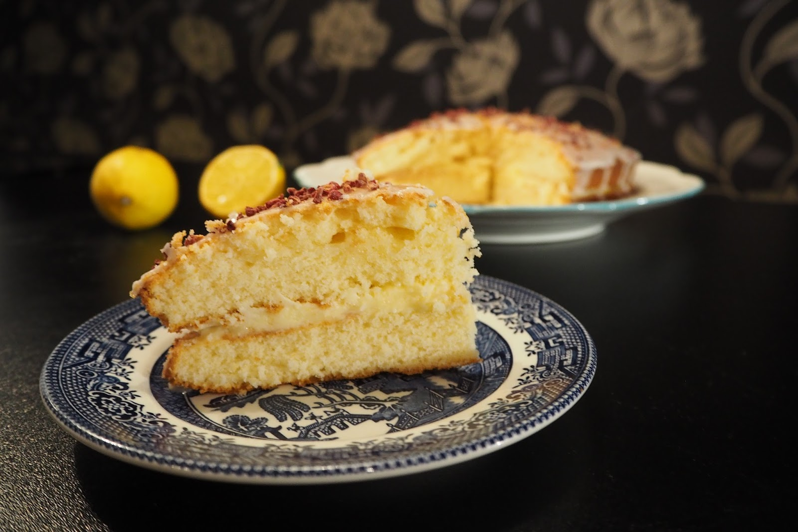 slide of lemon drizzle cake on blue plate