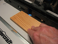 Cutting the grooves into the sides of the plywood pieces