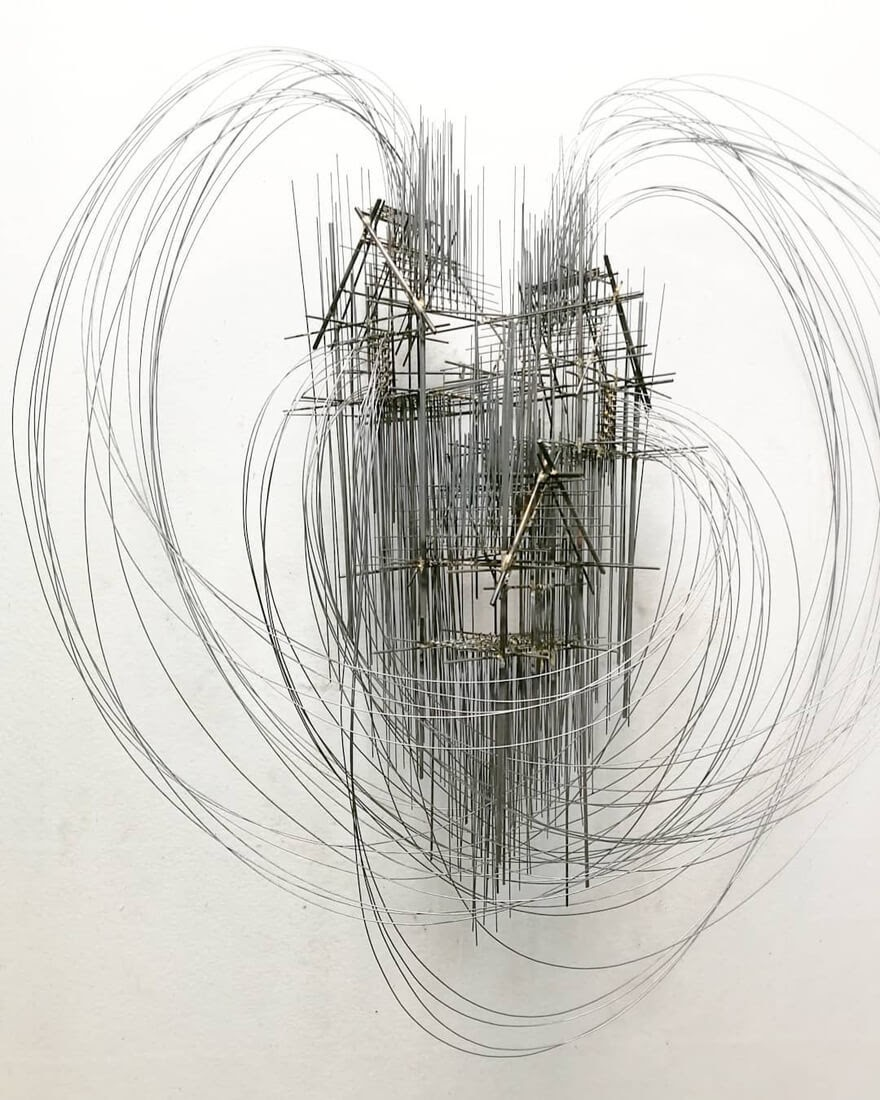 11-David-Moreno-Sketching-Architectural-Sculptures-with-Wire-www-designstack-co