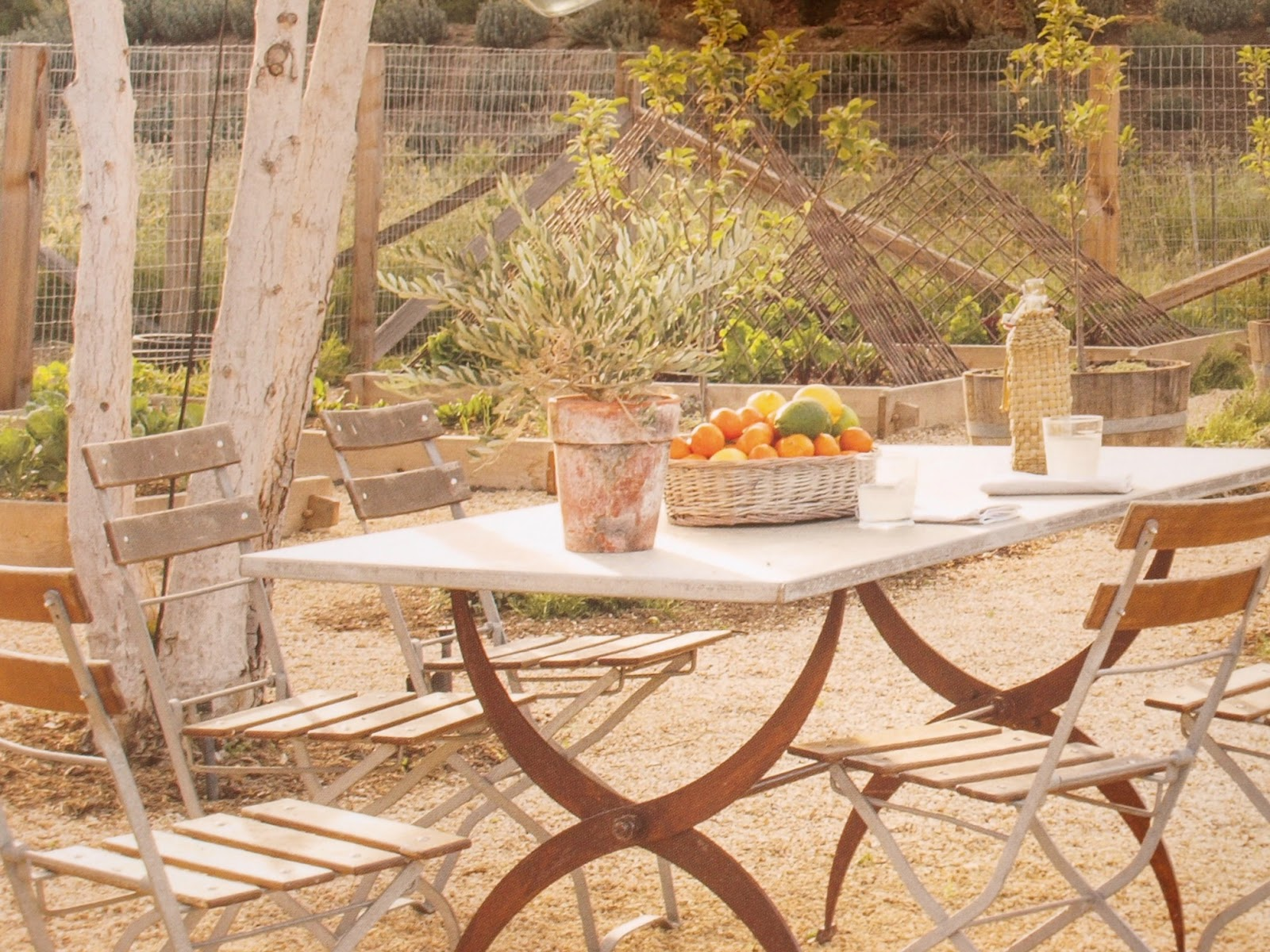 Charming bistro seating outside Patina Farm by Giannetti Home in Ojai, California #patinafarm