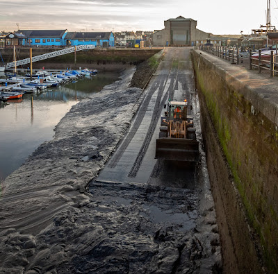 Photo of another view of the digger clearing mud from the slipway