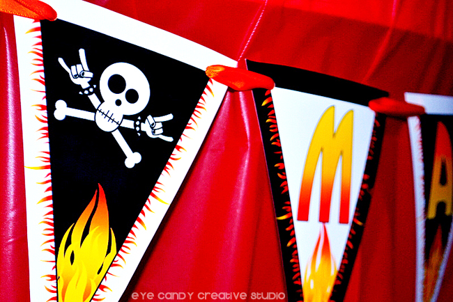 close up of rocker party banner, skull, flames, rock on, kiss my 30s goodbye
