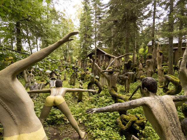 Mossy yoga people in southeastern Finland created by Veijo Rönkkönen