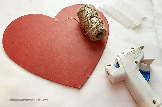 Vintage Paint and more - covering a thrift store wood heart shape with twine to create a vintage Valentine wall art