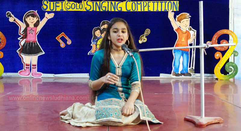A student singing during Inter House Sufi Singing Competition at Green Land Convent School