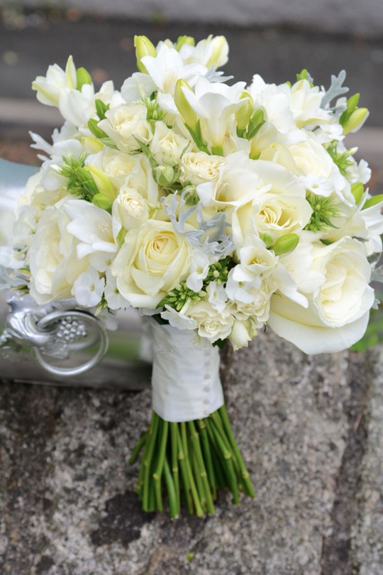 Compact ivory bridal bouquet of roses spring wedding