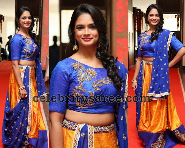 Model in Orange Blue Zardosi Lehenga