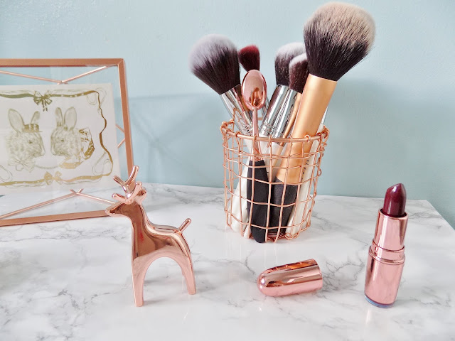 Copper Homeware Accessories with marble background