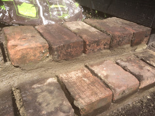 Steps made from bricks, life on pig row