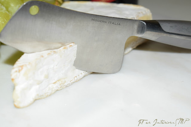 A Marble 12 X 12 tile used as a cutting board & Fine Cutlery