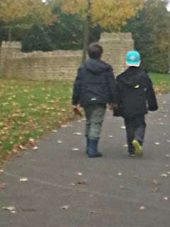 Two Boys Walking Away into Distance