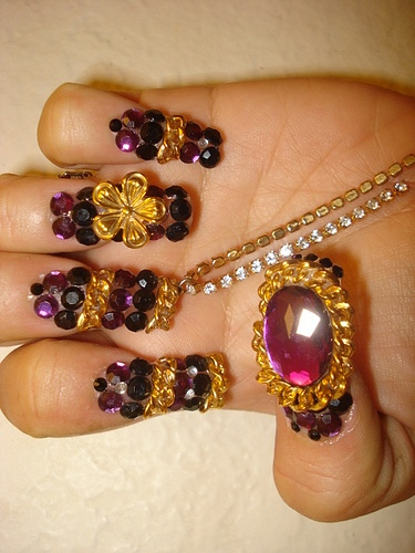 Fancy Nail Designs With Gold And Purple Gemstones