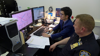 Leechaianan checks out a Compstat map on the computer.