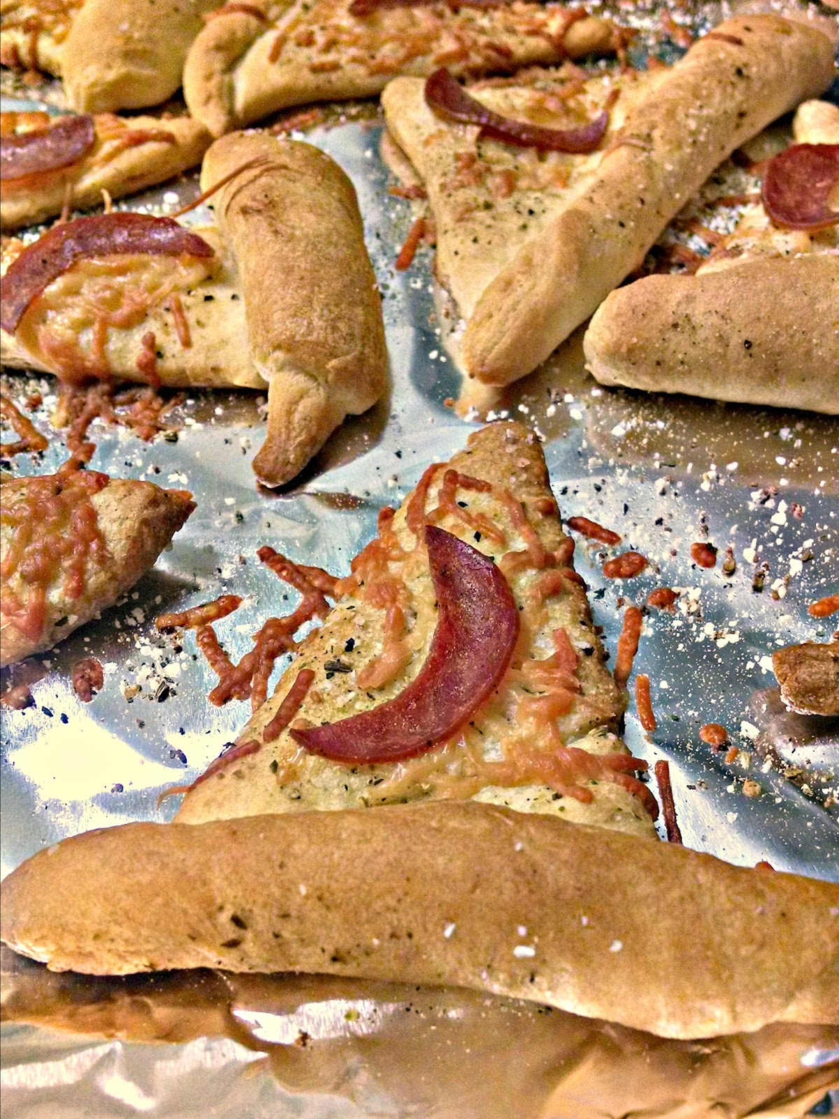 Witch Hats are quick to whip up with ingredients you probably already have. Some crescent roll dough, pepperoni, and Parmesan cheese make up these simple and tasty treats for Halloween.