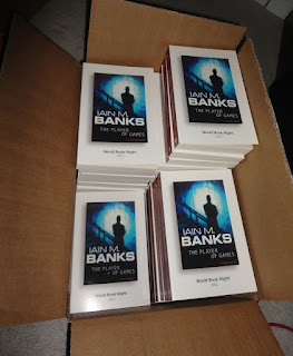 A box full of World Book Night books - Iain M. Banks, The Player of Games