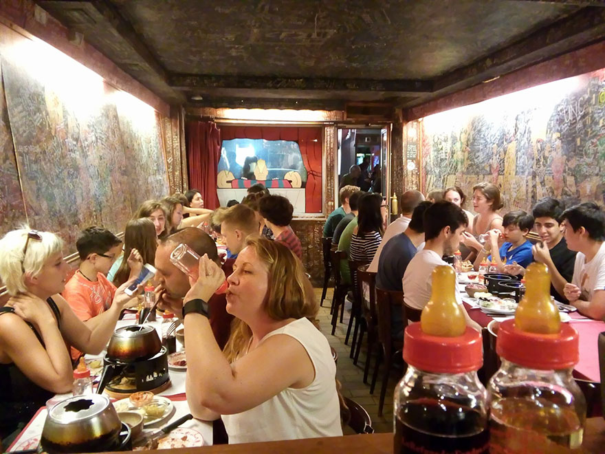 35 Of The World's Most Amazing Restaurants To Eat In Before You Die - Drink Wine From Baby Bottles, Le Refuge Des Fondus, Paris, France