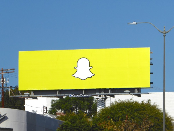 Yellow Snapchat ghost logo billboard