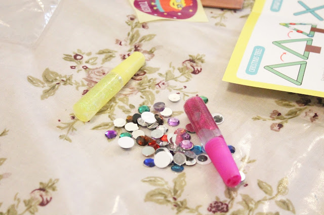 glitter glue sequins and bobbly eyes