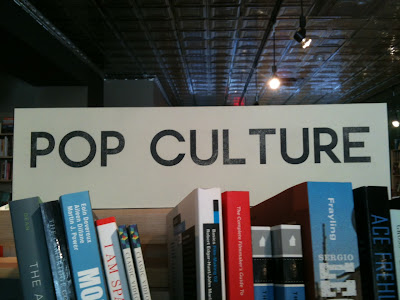 POP CULTURE section sign with large space between the L and T