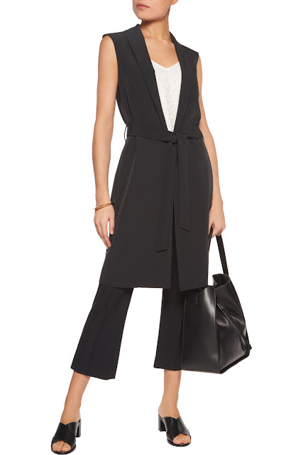 long black waist coat styled with trousers