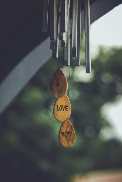 "Wind chimes spell ""I love you"" photo by Suresh Kumar"