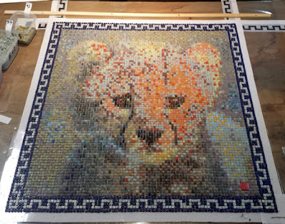 Cheetah cub mosaic portrait, all tiles laid. Ready to be glued on its support.