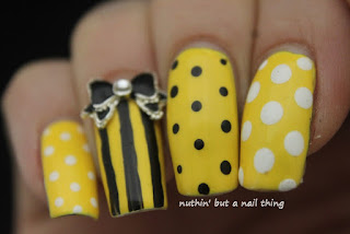 Sunshine yellow stripes and polka dots nail art ideas