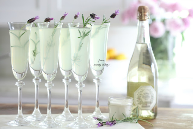 Lavender Lemonade in champagne flutes with fresh lavender for garnish
