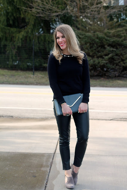 black leather pants, black embellished sweater, grey suede pumps, grey clutch, thrifted