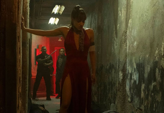 Hotel Artemis Review, Still, girl in red dress, Sofia Boutella in Hotel Artemis