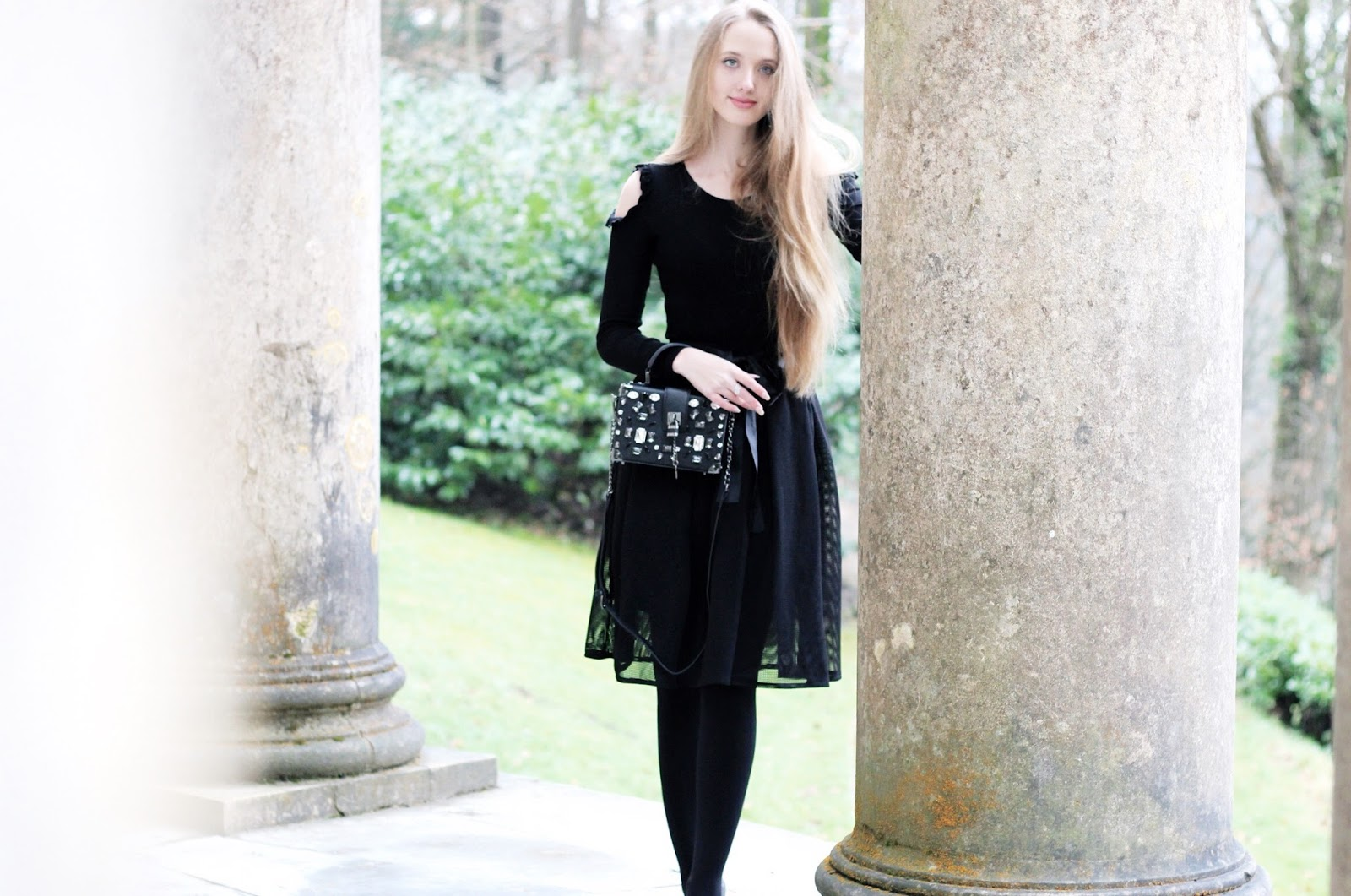 All black elegant winter evening outfit