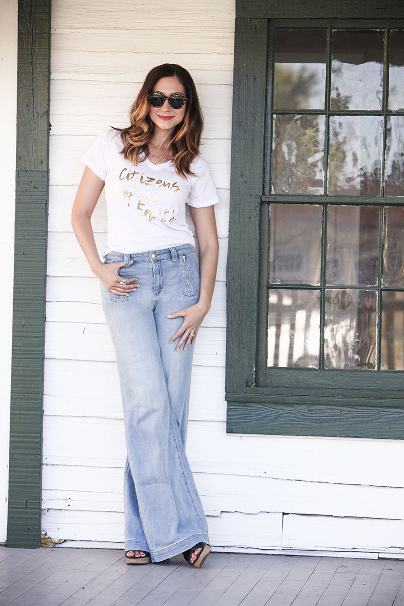 Amy West in the classic white v-neck Citizens of the Earth t-shirt.